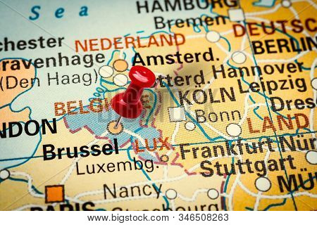 Prague, Czech Republic - January 12, 2019: Red Thumbtack In A Map. Pushpin Pointing At Brussels City