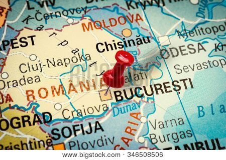 Prague, Czech Republic - January 12, 2019: Red Thumbtack In A Map. Pushpin Pointing At Bucharest Cit