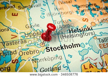 Prague, Czech Republic - January 12, 2019: Red Thumbtack In A Map. Pushpin Pointing At Stockholm Cit