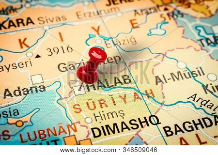 Prague, Czech Republic - January 12, 2019: Red Thumbtack In A Map. Pushpin Pointing At Aleppo City I