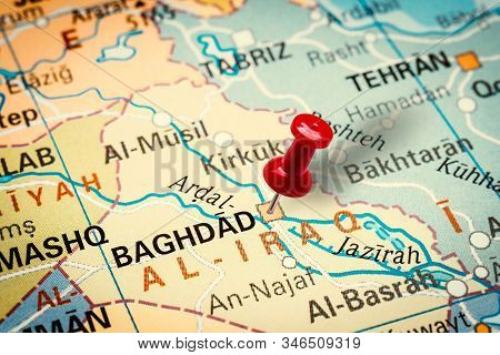 Prague, Czech Republic - January 12, 2019: Red Thumbtack In A Map. Pushpin Pointing At Baghdad City