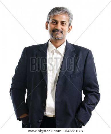 Good looking mature Asian Indian male with business suit isolated on white background