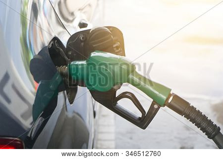 Petroleum Gas Station. Fuel Pump Colorful Petrol Pump Filling Nozzles.car At Gas Station Being Fille