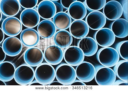 Blue Plastic Pipes Used In Construction Site.blue Pvc Water Pipe In Storage.packaged Blue Plastic Wa
