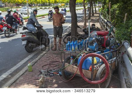 Ho Chi Minh City, Vietnam 2019-07-08: Repair Of Motorbikes In The Center Of Ho Chi Minh City