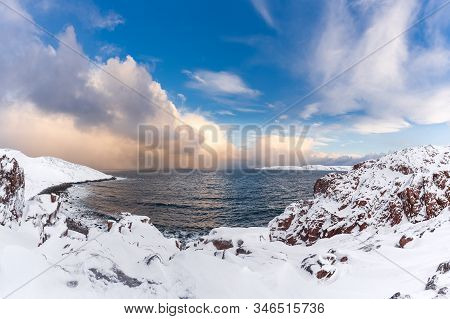Winter Panorama Of Barents Sea Gulf Surrounded By Snow Covered Rocky Shores In The Far North Above T