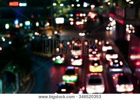 Defocussed Urban Traffic Background At Night With Colourful Bokeh - Blurred City Congestion At Road