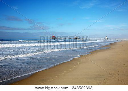 Huntington Beach Pier. Huntington Beach California aka Surf City with the Ocean, Waves, Beach and the World Famous Pier.