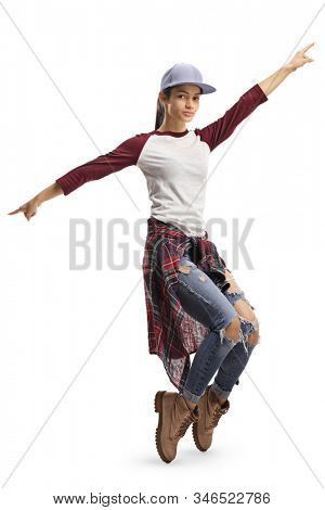 Full length shot of a girl dancing with arms and standing on tiptoes isolated on white background