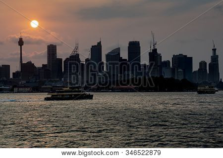 Ferries Making Their Way Across Sydney Harbour At Sunset