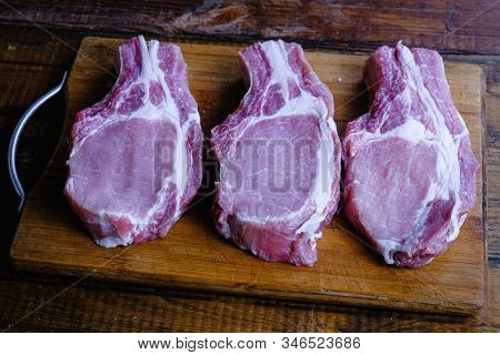 Fresh Raw Pork Loin With Ribs On A Wooden Background
