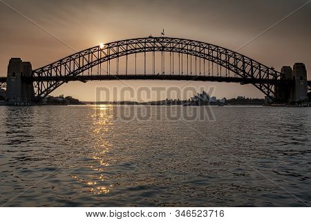 Sydney Harbour Bridge Seen Across The Water At Sunset