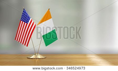 3d Illustration. American And Irish Flag Pair On A Desk Over Defocused Background