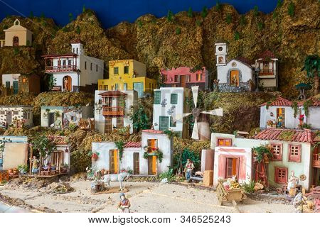 Candelaria, Tenerife, Spain - December 12, 2019: Christmas Belen -  Creche (crib), statuette of people and houses in miniature