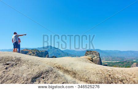Meteora, Kalambaka, Greece - September 18, 2019: Tourists  at view point ion the rocks in Meteora