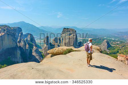 Meteora, Kalamaka, Greece - September 17, 2019: Tourist at view point on the rock in Meteora