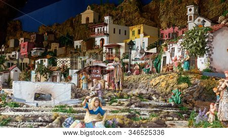 Candelaria, Tenerife, Spain - December 12, 2019: Christmas Belen -  Statuette of people and houses in miniature depicting of life of town