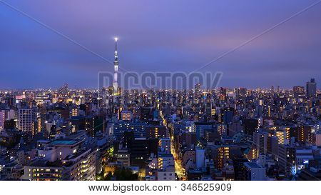 Night Light Cityscape View With Modern Building In Tokyo, Japan