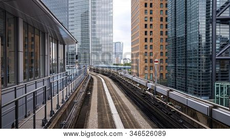 Japan Rapid Train On The Rail Track With Modern Building In The City, Transportation In Tokyo City,