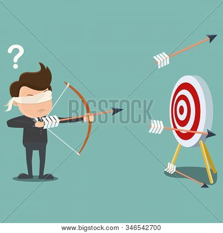 Blindfolded Businessman Shooting Arrow , Business Concept . Blindfolded Businessman.