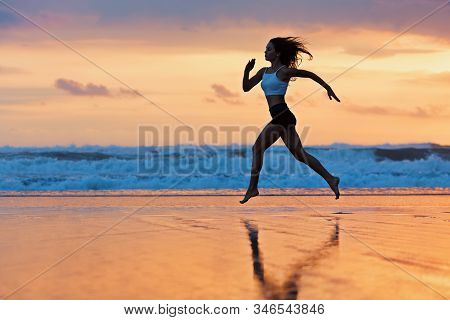 Barefoot Young Girl With Slim Body Running Along Sea Surf By Water Pool To Keep Fit And Burning Fat.