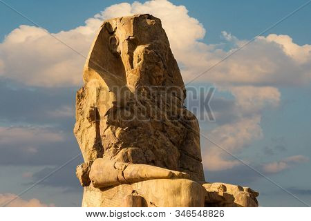 Colossi Of Memnon Luxor Thebes Against The Background Of Dawn In The Egypt
