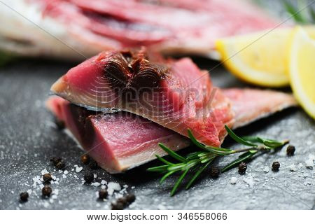 Raw Fish Seafood On Black Plate Background , Longtail Tuna , Eastern Little Tuna Fillet Ingredients