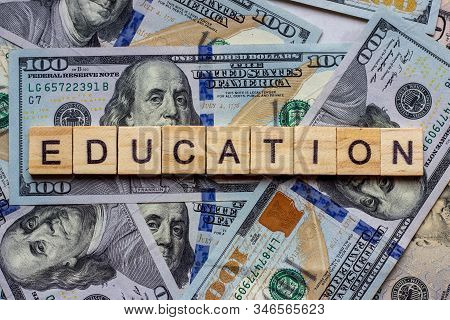 The Word Education On Dollar Usa Background. College Credits, Graduation Funds, Tuition Money Concep