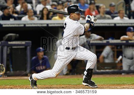 BRONX, NY - AUG 14: New York Yankees shortstop Derek Jeter (2) singles to center against the Texas Rangers during the seventh inning on August 14, 2012 at Yankee Stadium.