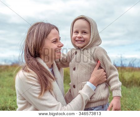 Woman Mother With Child, Little Son Boy 4-5 Years Old, Autumn Park, Hugging Game, Fun, Emotions Happ