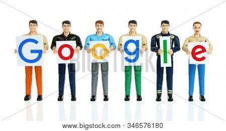 Kiev, Ukraine - October 29, 2019: Toys People Holds Paper Letters Of Google Logo. Google Is An Ameri