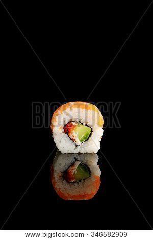 Delicious Philadelphia Sushi With Avocado, Creamy Cheese, Salmon And Masago Caviar Isolated On Black