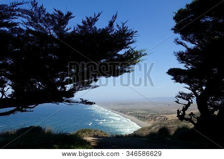 Trees Frame An Aerial View Of Waves Crashing On To Point Reyes National Seashore In Northern Califor