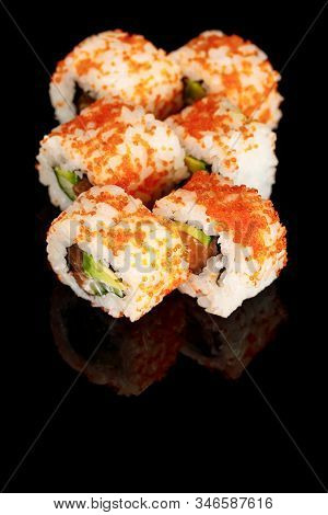 Delicious California Roll With Avocado, Salmon And Masago Caviar Isolated On Black