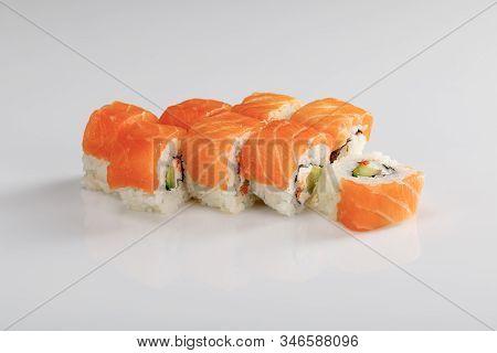 Delicious Philadelphia Sushi With Avocado, Creamy Cheese, Salmon And Masago Caviar On White Backgrou