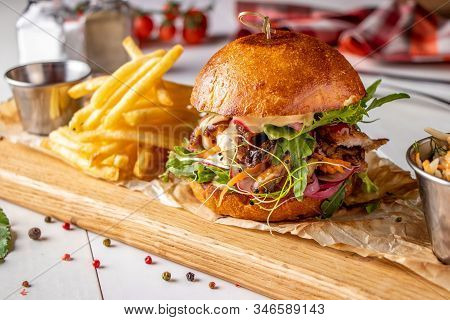 Vegetarian Fresh Burger With Mushrooms And Vegetables, Served With French Fries On A Wooden Board, H