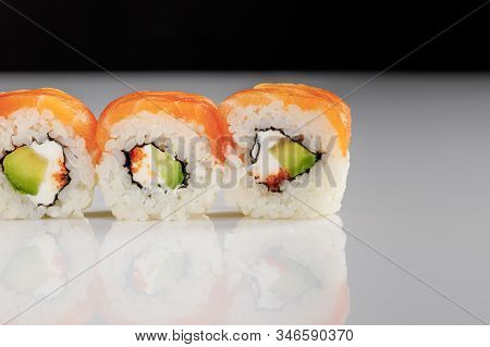Close Up View Of Delicious Philadelphia Sushi With Avocado, Creamy Cheese, Salmon And Masago Caviar