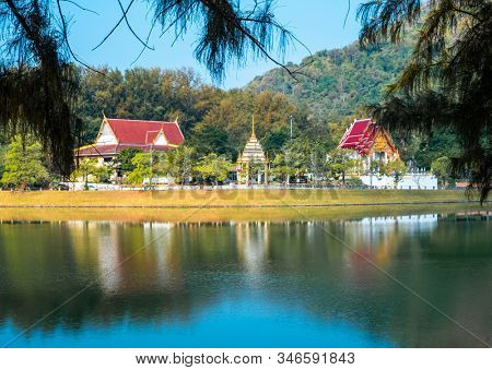 Temple with its reflection in the lake on the Nai Harn beach in Phuket, Thailand