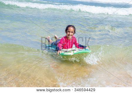 Little Girl Swimming In Maracas Bay Beach Trinidad And Tobago Having Fun Splashing In The Waves