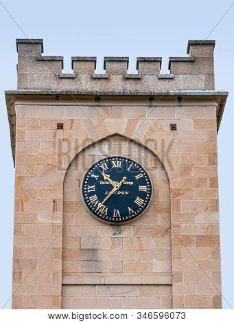 Richmond, Tasmania, Australia - December 13, 2009: Saint Luke Church. Focus On Dark Blue Clock With