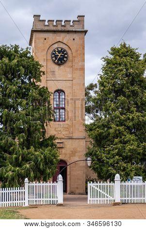Richmond, Tasmania, Australia - December 13, 2009: Saint Luke Church. Beige Stone Tower With Entranc