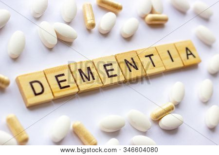 The Medical Phrase Dementia On Different Pills And Capsules Background. Pharmacy Theme, Health Care,