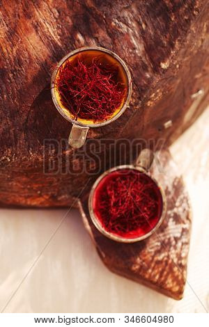 saffron threads  in vintage dishes, truly color, soft focus
