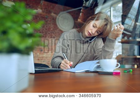 Beautiful Caucasian Business Lady Working In Office With Laptop. Young Female Model In Co-working Pl