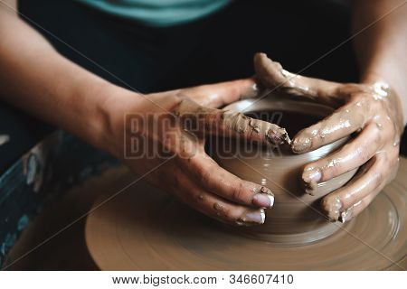 Pottery Concept. Professional Ceramist Working With Clay At Throwing Table In Workshop.