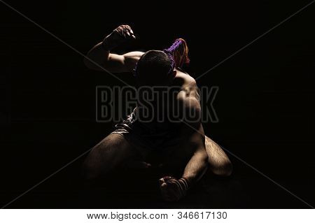 Thai Boxer Punches On The Floor Of The Ring. Mongkhon. The Concept Of Tournaments, Thai Boxing And K