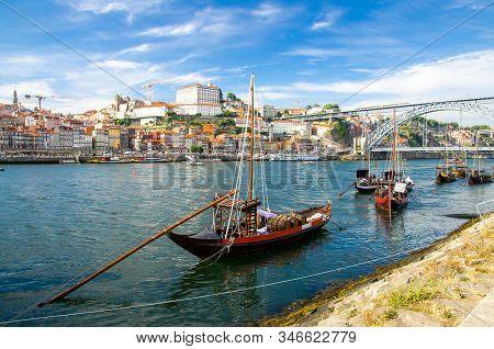 Portugal, City Landscape Porto, Colored Wooden Boats With Wine Port Barrels On Douro River, Panorami