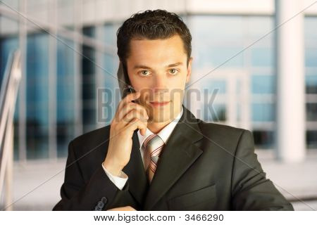 Close-Up Portrait. Businessman Outside A Modern Building.