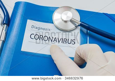 Novel Coronavirus Disease 2019-ncov Written On Blue Folder.