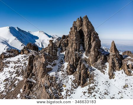 Epic Cliffs High In The Snowy Mountains. Sunny Day In The Mountains In Winter. Mountains Zailiysky A